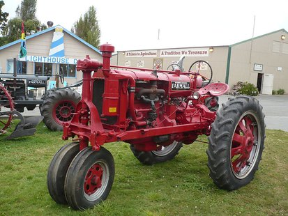 "An old Farmall Tractor on display during the Humboldt County Fair, in Ferndale, California. The 2013 theme was ""A Tribute To Agriculture"" with a large display of old farm equipment By Ellin Beltz (Own work) [Public domain], via Wikimedia Commons"