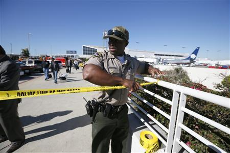 An airport police officer cordons off terminals 2 and 3 after a shooting at Los Angeles airport (LAX), California November 1, 2013.  REUTERS/Lucy Nicholson