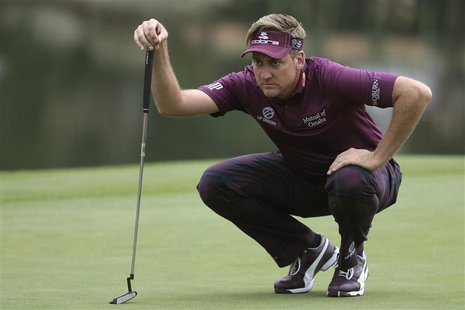 Ian Poulter of England looks over his putt on the 18th green during the third round of the WGC-HSBC Champions golf tournament in Shanghai No