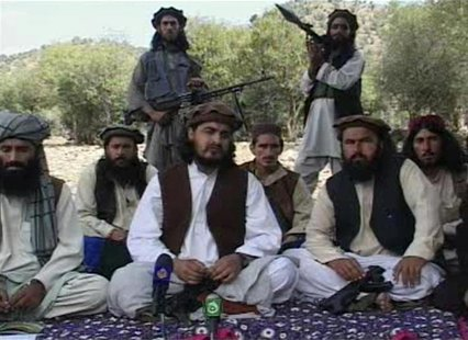 Pakistani Taliban chief Hakimullah Mehsud (C) sits with other militants in South Waziristan, in this file still image taken from video shot