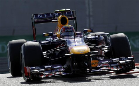 Red Bull Formula One driver Mark Webber of Australia takes a corner during the third practice session of the Abu Dhabi F1 Grand Prix at the