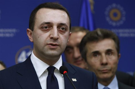 Georgia's Interior Minister Irakly Garibashvili speaks during a news conference as Prime Minister Bidzina Ivanishvili looks on in Tbilisi, N