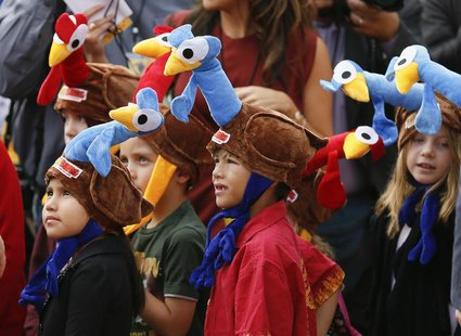 "Children wear promotional turkey hats at the world premiere of the animated film ""Free Birds"" in Los Angeles, October 13, 2013. REUTERS/Dann"
