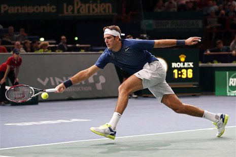 Juan Martin Del Potro of Argentina stretches to return to Marin Cilic of Croatia at the Paris Masters men's singles tennis tournament at the