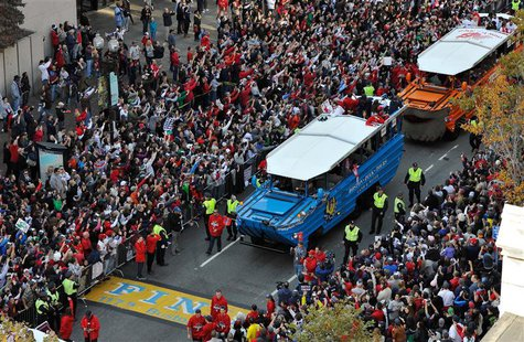 Nov 2, 2013; Boston, MA, USA; An overhead view as duck boats carry Boston Red Sox players across the marathon finish line during the World S