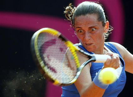 Italy's Roberta Vinci hits a return to Russia's Alexandra Panova during their Fed Cup World Group women's tennis final match in Cagliari, No