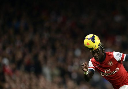 Arsenal's Bacary Sagna heads the ball during their English Premier League soccer match against Liverpool at the Emirates stadium in London N