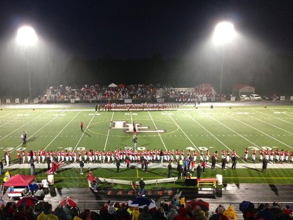 The Lakeshore Lancers (foreground) and Coldwater Cardinals (background) line up before their MHSAA Division 3 Football Pre-District game at Al Stockman Stadium in Stevensville, MI on November 1, 2013.