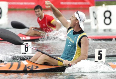 Australian Nathan Baggaley celebrates his victory in the men's K1, 500 metres race during the flat water Canoe and Kayak World Championship