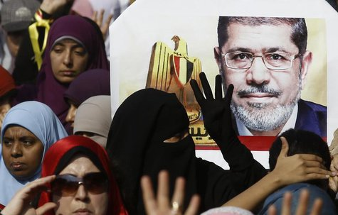 Supporters of the Muslim Brotherhood and ousted Egyptian President Mohamed Mursi take part in a protest against the military and interior mi