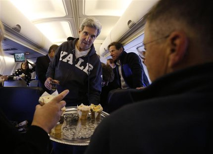 U.S. Secretary of State John Kerry offers cupcakes to members of the travelling press between Washington and the Middle East, November 2, 20