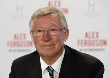 Former Manchester United manager Alex Ferguson poses before a news conference for his new autobiography at the Institute of Directors in Lon