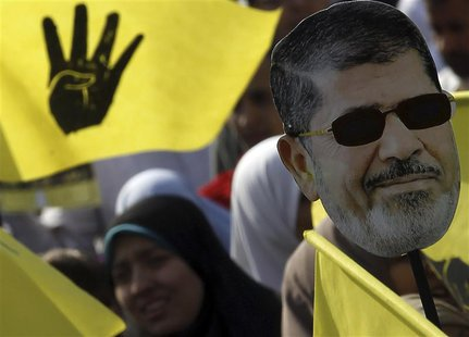 A supporter of the Muslim Brotherhood and ousted Egyptian President Mohamed Mursi takes part in a protest against the military and interior