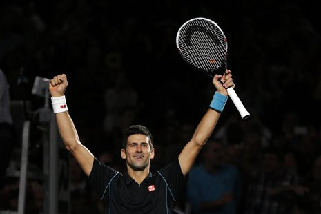 Novak Djokovic of Serbia reacts after defeating David Ferrer of Spain in the men's singles final match at the Paris Masters men's singles te