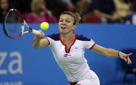 Simona Halep of Romania returns a shot to Samantha Stosur of Australia during the Tournament of Champions women's singles final tennis match
