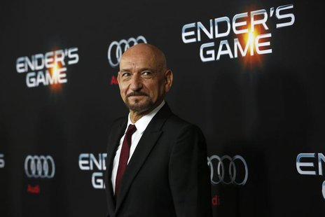"Cast members Ben Kingsley poses at the premiere of ""Ender's Game"" at the TCL Chinese theatre in Hollywood, California October 28, 2013. The"