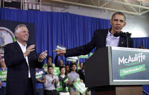 U.S. President Barack Obama delivers remarks at a campaign event for Terry McAuliffe (L) for Governor in Arlington, Virginia, November 3, 20