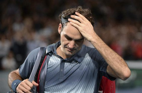Roger Federer of Switzerland leaves the court after being defeated by Novak Djokovic of Serbia in their semi-final match at the Paris Master
