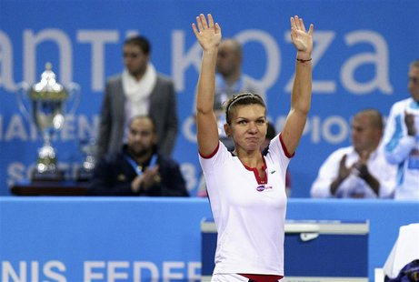 Simona Halep of Romania celebrates defeating Samantha Stosur of Australia during the WTA Tournament of Champions final match in Sofia Novemb