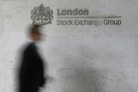A man walks past the London Stock Exchange in the City of London October 11, 2013. REUTERS/Stefan Wermuth