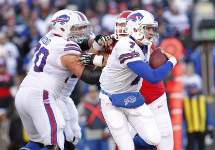 Nov 3, 2013; Orchard Park, NY, USA; Buffalo Bills quarterback Jeff Tuel (7) is chased from the pocket by the Kansas City Chiefs defense duri