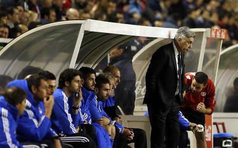 Real Madrid's coach Carlo Ancelotti (standing) reacts during their Spanish first division soccer match against Rayo Vallecano at Vallecas st