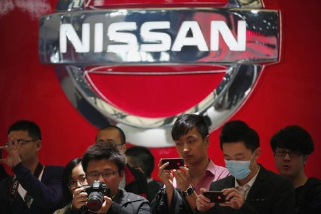 People take pictures of Nissan cars during the 15th Shanghai International Automobile Industry Exhibition in Shanghai April 21, 2013. REUTER