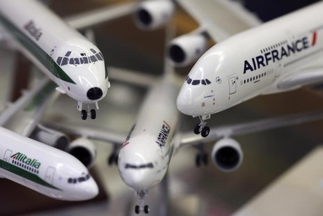 Scale models of Alitalia and Airfrance airplanes are displayed at a shop selling models of vehicles in Rome October 31, 2013. REUTERS/Alessa