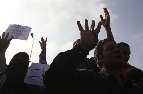Supporters of the Muslim Brotherhood and ousted Egyptian President Mohamed Mursi shout slogans against the military and interior ministry, w