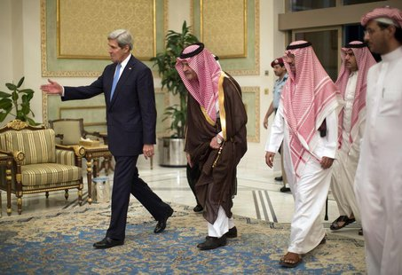 U.S. Secretary of State John Kerry is greeted by Saudi Foreign Minister Prince Saud Al-Faisal bin Abdulaziz al-Saud (C), as Kerry arrives in
