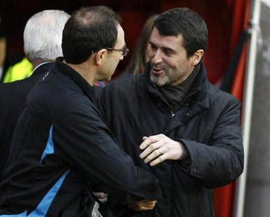 Sunderland's coach Roy Keane (R) greets Aston Villa's coach Martin O'Neil ahead of their English Premier League soccer match at The Stadium