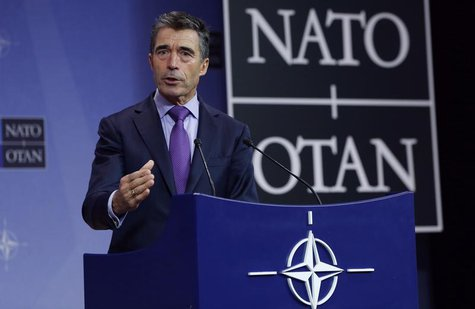 NATO Secretary-General Anders Fogh Rasmussen holds a news conference during a NATO defence ministers meeting at the Alliance headquarters in
