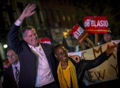Democratic New York City mayoral candidate Bill de Blasio and his wife Chirlane McCray greet spectators during the Park Slope Halloween Para