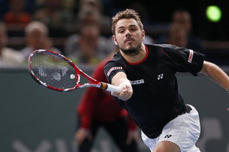 Stanislas Wawrinka of Switzerland prepares to return to Novak Djokovic of Serbia at the Paris Masters men's singles tennis tournament at the