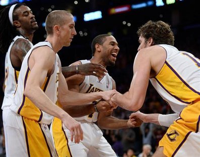 Nov 3, 2013; Los Angeles, CA, USA; Los Angeles Lakers shooting guard Xavier Henry (7) smiles as he helps up teammate Paul Gasol (16, right)