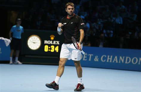 Stanislas Wawrinka of Switzerland celebrates breaking serve in the first set during his men's singles tennis match against Tomas Berdych of