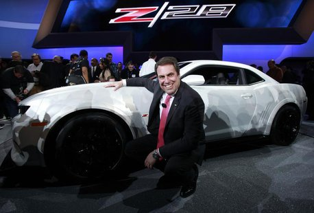 Mark Reuss, President of General Motors North America poses for photographers with the new Chevrolet Camaro Z/28 during a news conference at