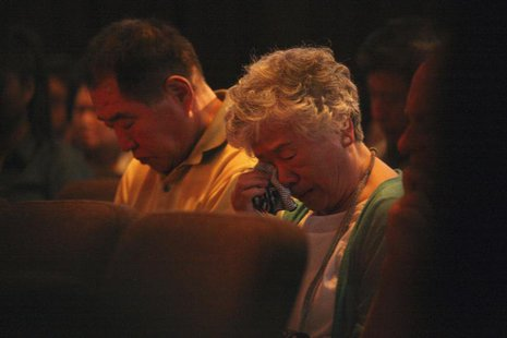 Sung Seo and Myunghee Bae, parents of Kenneth Bae during a vigil for Kenneth in Seattle, Washington August 10, 2013. REUTERS/Matt Mills McKn