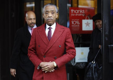 Rev. Al Sharpton leaves Macy's department store, after meeting with company officials in New York, November 4, 2013. REUTERS/Adam Hunger