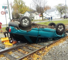 Car on railroad tracks following accident at East Park Avenue and South Jefferson Street, Coldwater, November 4, 2013