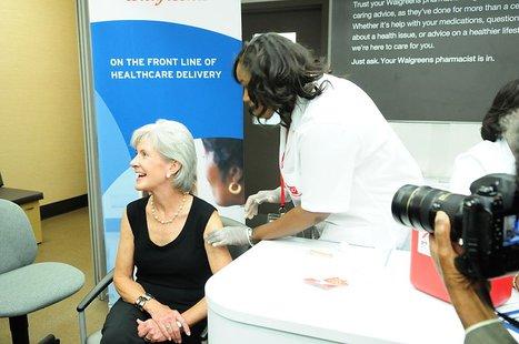 HHS Secretary Sebelius receives her flu shot while visiting a Walgreens in Chicago, IL on Wednesday October 5, 2011. Photo by Michael Schmitt By HHSgov [Public domain], via Wikimedia Commons