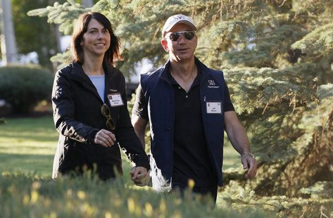 Amazon CEO Jeff Bezos (R) and his wife MacKenzie arrive at the annual Allen and Co. conference at the Sun Valley, Idaho Resort July 12, 2013