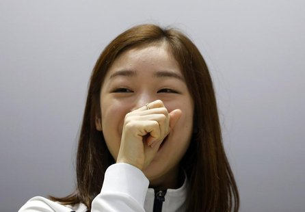 South Korean figure skater Kim Yuna smiles as she listens to questions during a news conference ahead of Sochi 2014 Winter Olympics, at the