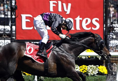 Jockey Damien Oliver crosses the finish line riding race favourite Fiorente to win the A$6 million ($5.7 million) Melbourne Cup at Flemingto