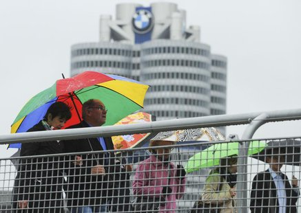 Shareholders arrive for the German luxury carmaker BMW annual shareholders meeting at the company's headquarters in Munich, May 16, 2012 May