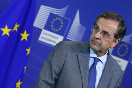 Greece's Prime Minister Antonis Samaras attends a news conference after a meeting with European Commission President Jose Manuel Barroso at