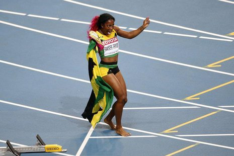 Shelly-Ann Fraser-Pryce of Jamaica celebrates winning the women's 100 metres final during the IAAF World Athletics Championships at the Luzh