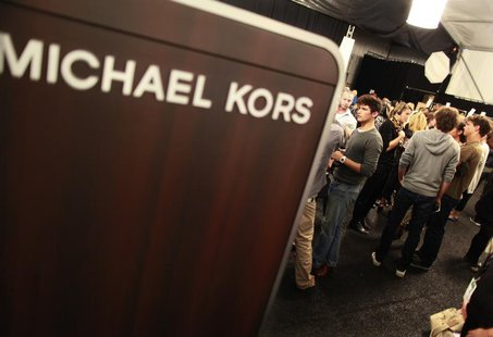 Models and staff prepare backstage before the Michael Kors Spring 2011 collection during New York Fashion Week September 15, 2010. REUTERS/B
