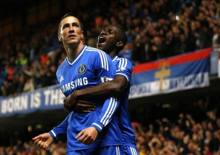 Chelsea's Fernando Torres (L) celebrates with team mate Ramires after scoring a goal against Manchester City during their English Premier Le