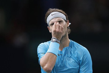 Rafael Nadal of Spain reacts as he faces David Ferrer of Spain in their semi-final match of the Paris Masters men's singles tennis tournamen